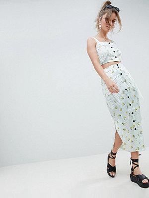 ASOS DESIGN satin midi skirt with fringe detail in ditsy print co-ord