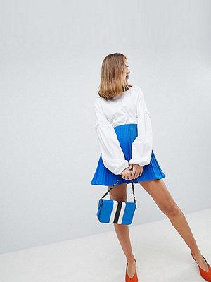 ASOS Petite ASOS DESIGN Petite pleated mini skirt - Cobalt blue