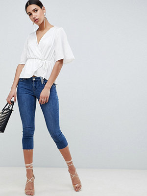 ASOS DESIGN Whitby Low Rise Skinny Jeans In Capri Length In London Blue - London