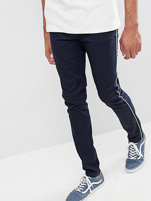 ASOS DESIGN Tall Skinny Chinos In Navy With White Piping