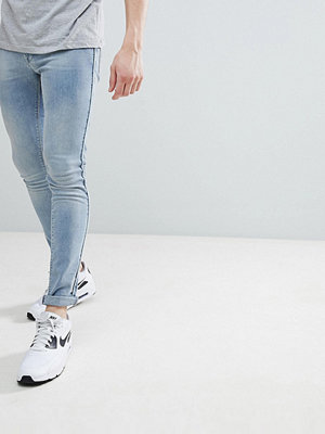 ASOS DESIGN Extreme Super Skinny Jeans In Light Wash Blue With Piping - Light wash blue