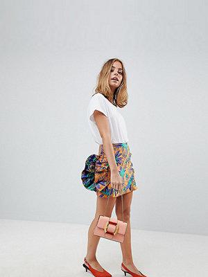 ASOS Petite ASOS DESIGN Petite mini skirt with frill in tropical jacquard