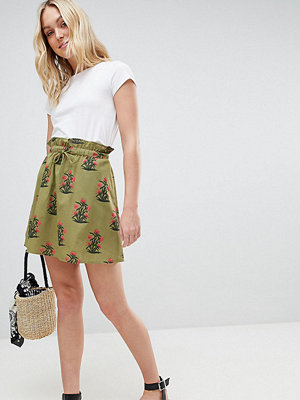 Asos Tall ASOS DESIGN Tall cotton mini skater skirt with pockets in green floral print