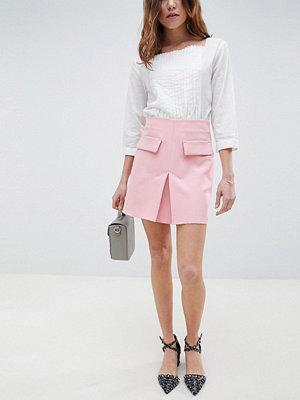 ASOS DESIGN a line mini skirt with pocket front detail - Blush