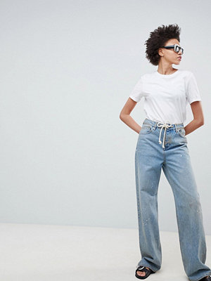 ASOS DESIGN Skater Jeans In Aged Vintage Wash With Rope Belt - Vintage mid wash