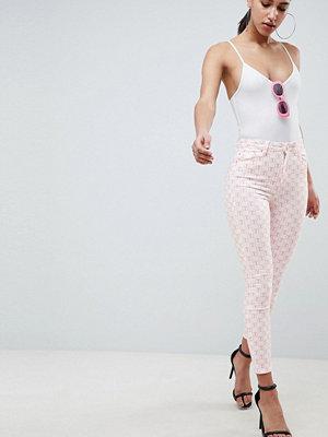 ASOS DESIGN Ridley Rosa enfärgade smala jeans med hög midja White mono
