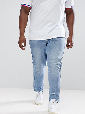 ASOS DESIGN Plus Skinny Twisted Seam Jeans In Light Wash Blue With Abrasions - Light wash blue