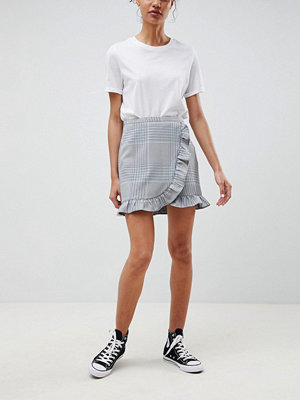 ASOS DESIGN tailored check mini skirt with ruffle - Check