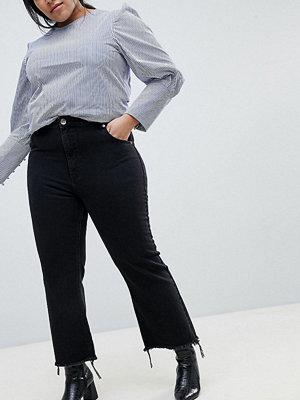 ASOS Curve ASOS DESIGN Curve Egerton rigid cropped flare jeans in washed black with raw hem - Washed black