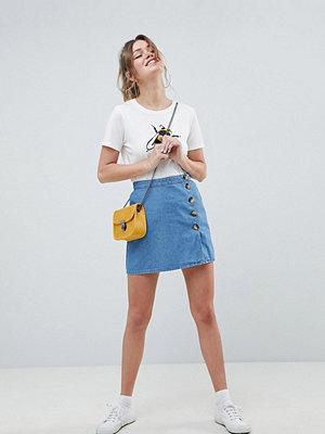 ASOS DESIGN denim button through wrap skirt
