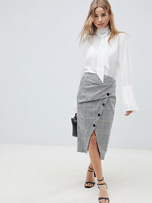 ASOS DESIGN wrap pencil skirt in check with buttons