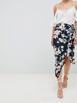 ASOS DESIGN floral print midi skirt with tie side and thigh split