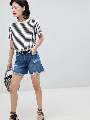 River Island Slitna jeansshorts i boyfriendmodell Mid auth