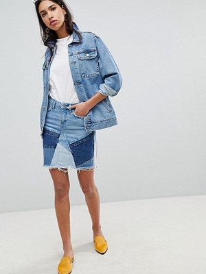 River Island Kort jeanskjol med dekonstruerat lapptäcksmönster Mid auth