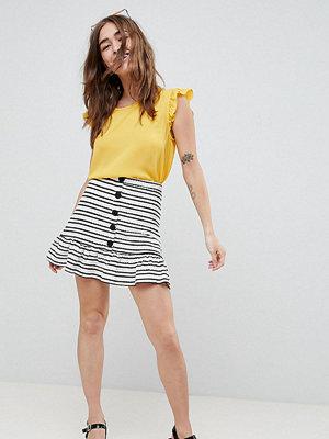 ASOS Petite ASOS DESIGN Petite stripe mini skirt with pep hem and button front - Cream/black