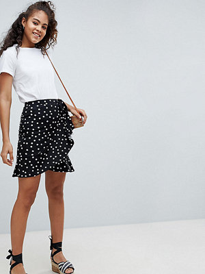 Asos Tall ASOS DESIGN Tall mini wrap skirt in polka dot print - Mono