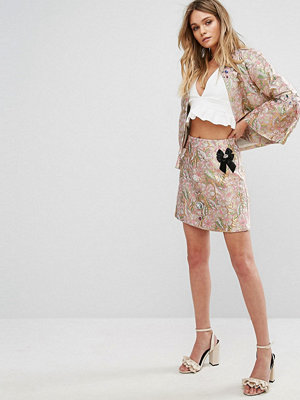 River Island Metallic-färgad kjol i jacquard med brosch Rosa mönster