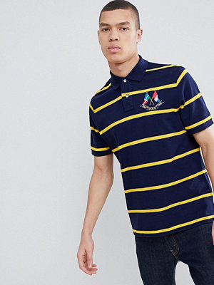 Polo Ralph Lauren Bring It Back Embroidered Flags Stripe Pique Polo Custom Regular Fit in Navy/Yellow - Cruise navy/ye