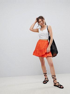 ASOS DESIGN cotton mini skirt with wrap detail - Burnt orange
