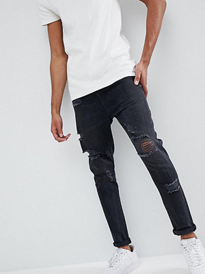 ASOS DESIGN Tall Drop Crotch Jeans In Washed Black With Heavy Rips - Washed black