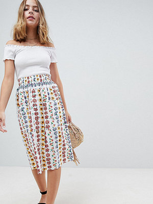 ASOS Petite cotton midi skirt with button front in floral print