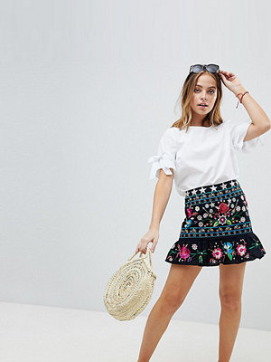ASOS Petite ASOS DESIGN Petite star embroidered mini skirt with pep hem - Multi