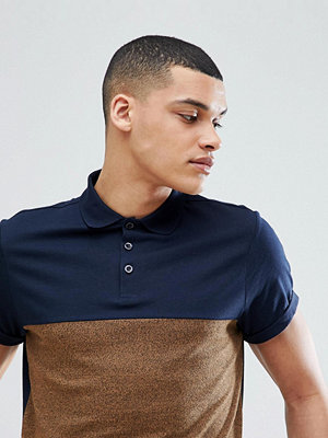 ASOS DESIGN polo shirt with contrast yoke and roll sleeve in twisted jersey - Navy