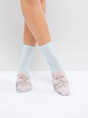 Monki Ljusblå strumpor med tjurig katt i ombre Ljusblå