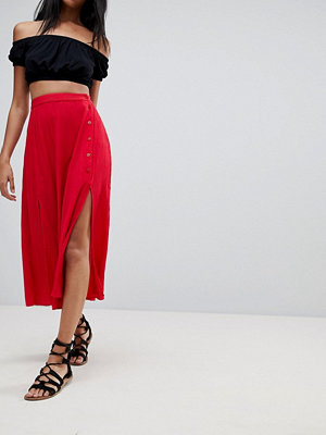 ASOS DESIGN crinkle midi skirt with buttons and double split