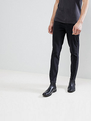 ASOS DESIGN Tall Skinny Twisted Seam Jeans