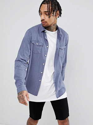 ASOS DESIGN regular fit garment dyed vintage wash shirt in blue