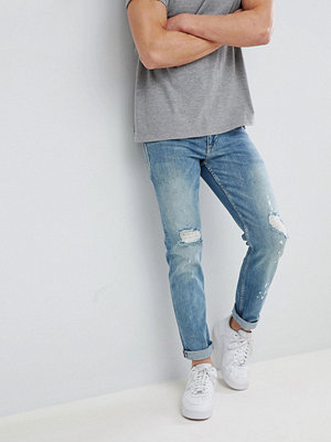 ASOS DESIGN Slim Jeans In Mid Wash Blue With Rips - Mid wash blue