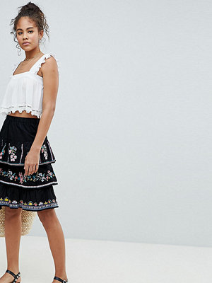 Asos Tall ASOS DESIGN Tall tiered mini sun skirt with embroidery