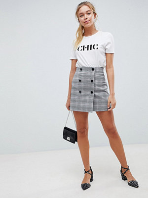 ASOS DESIGN double breasted mini skirt in check