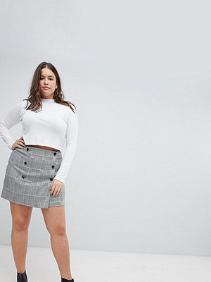 ASOS Curve ASOS DESIGN Curve double breasted mini skirt in yellow and blue check