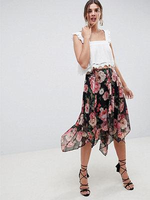 ASOS DESIGN soft floral print midi skirt with layered hanky hem
