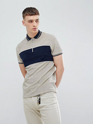 ASOS DESIGN polo shirt with cut and sew body panel and zip neck