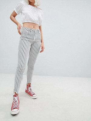 Pull&Bear Randiga skinny jeans med fransiga benslut