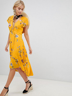 Free People Lost In You floral dip hem wrap dress - Yellow combo