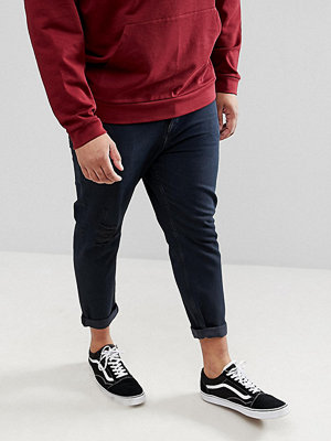 ASOS DESIGN Plus Tapered Jeans In Overdyed Wash With Rips - Dark wash blue