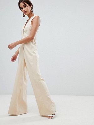 ASOS DESIGN Figursydd jumpsuit med vida ben Sandfärgad