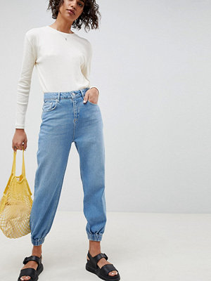 ASOS DESIGN denim track pant in light vintage wash