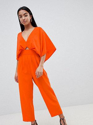 ASOS Petite ASOS DESIGN Petite jumpsuit with kimono sleeve and peg leg - Orange