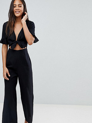 Asos Tall ASOS DESIGN Tall tea jumpsuit with cut out and tie detail in linen