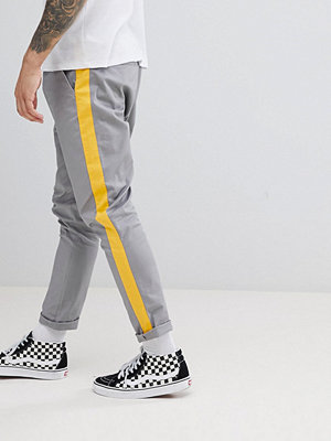 ASOS DESIGN Tapered Trousers In Grey With Yellow Side Stripe