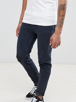 ASOS DESIGN Tall Tapered Jeans In Overdyed Wash With Rips - Dark wash blue