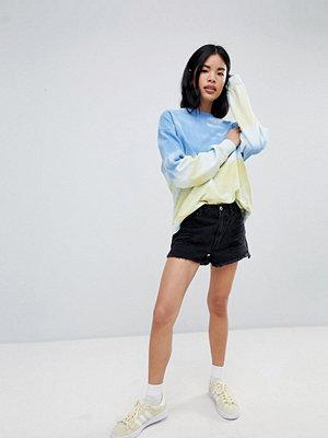 Pull&Bear Slitna jeansshorts med fransad kant