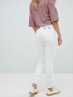 Vivienne Westwood Anglomania Broderade skinny jeans med hög midja och råskuren fåll