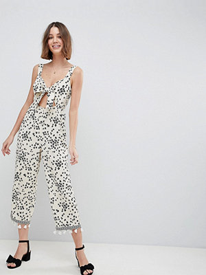 ASOS DESIGN floral jumpsuit with cut out and tie detail