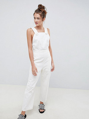 ASOS DESIGN denim jumpsuit in white with popper detail